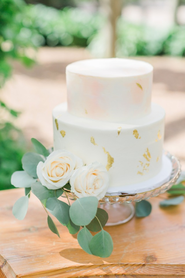 soft peach and blush watercolor and gold leaf wedding cake