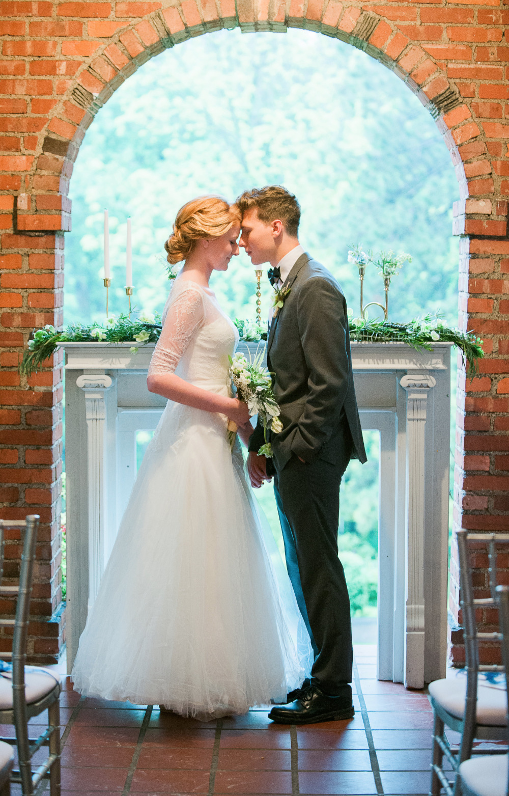 beautiful wedding ceremony with brick archway