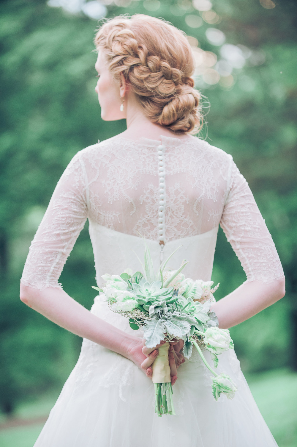 beautiful braided wedding hairstyle and succulent bouquet