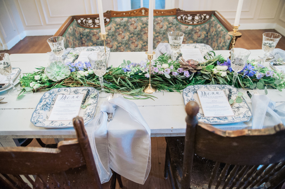 wedding reception layout with floral garland