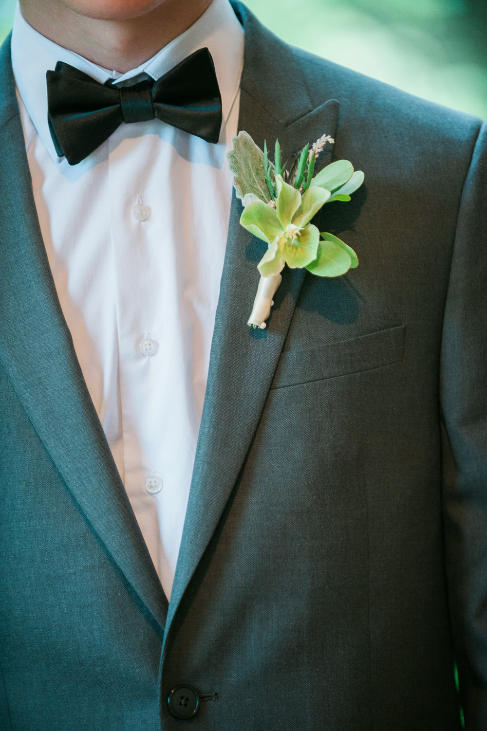 classic groomsmen attire with greenery boutonniere