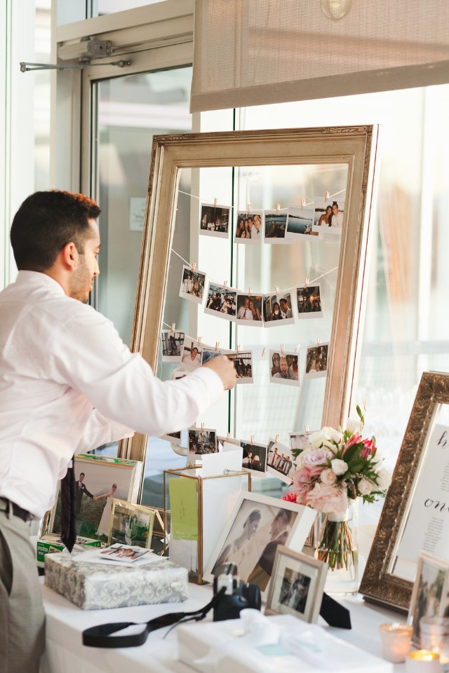 hanging photo display at the gift table