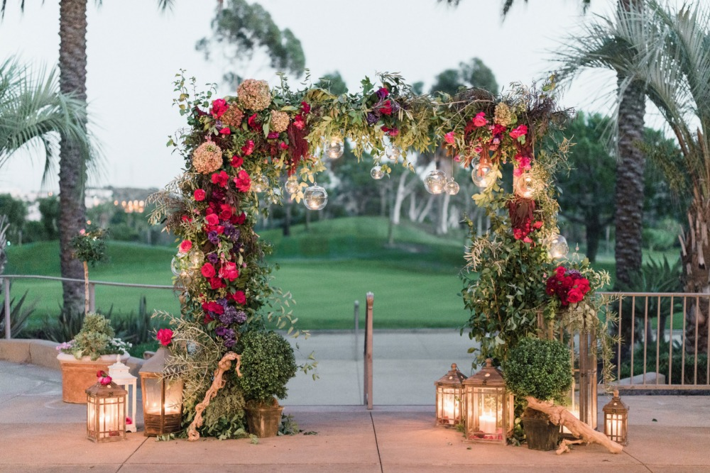 Candle lit wedding arbor