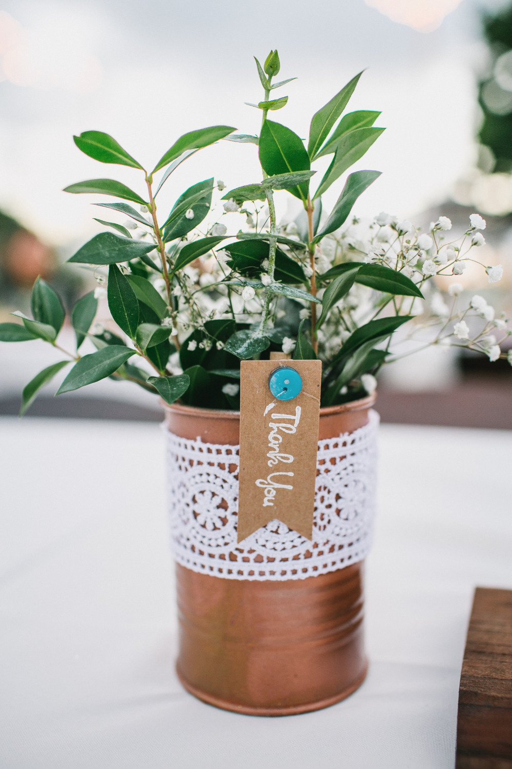 tin can with flowers favor