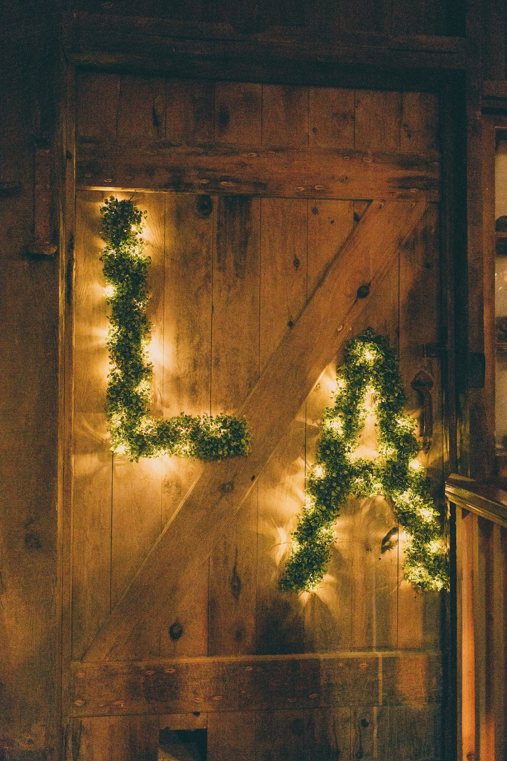 twinkle lights and greenery wedding initials