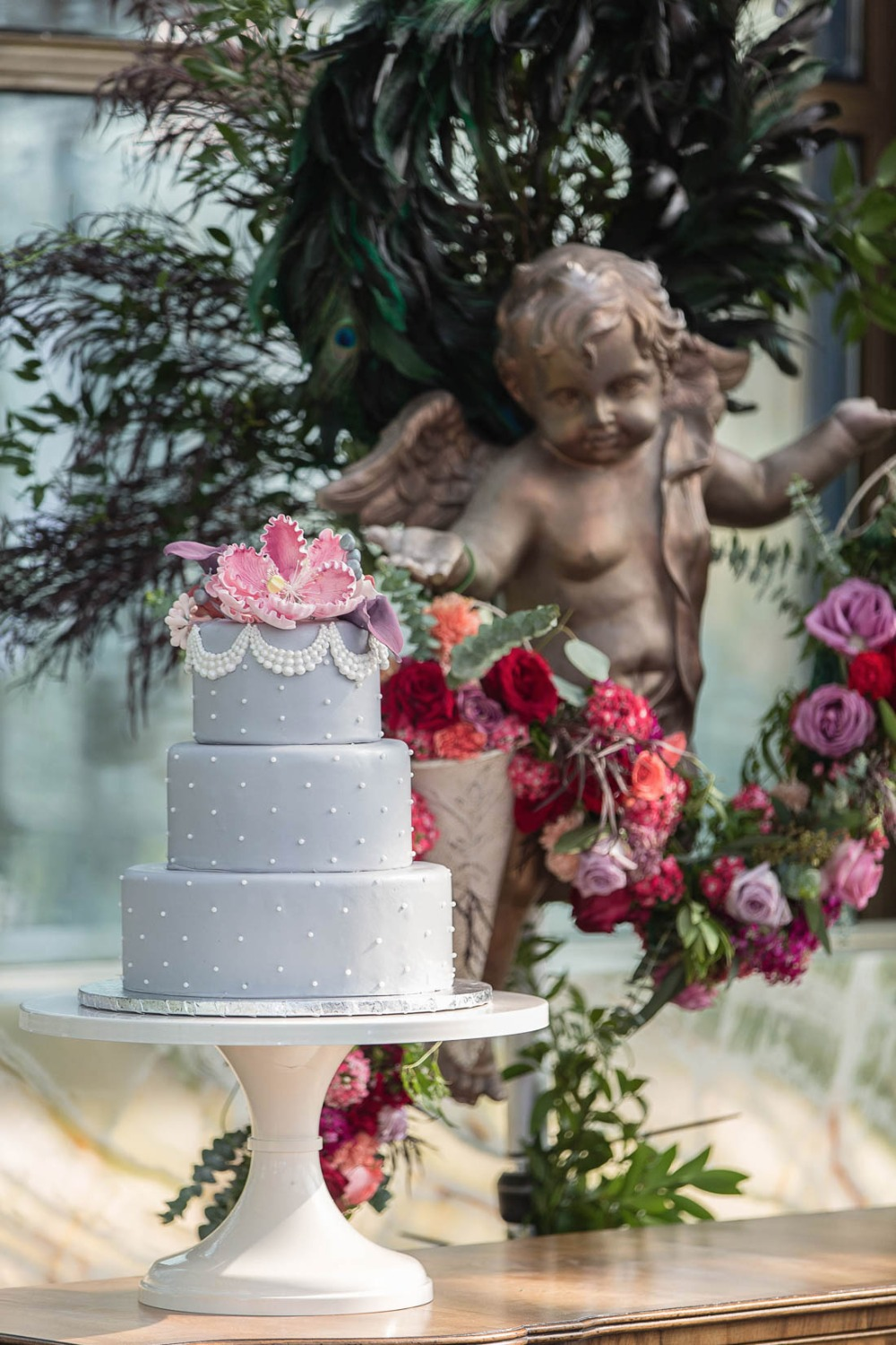 Pink and blue wedding cake with pearl details