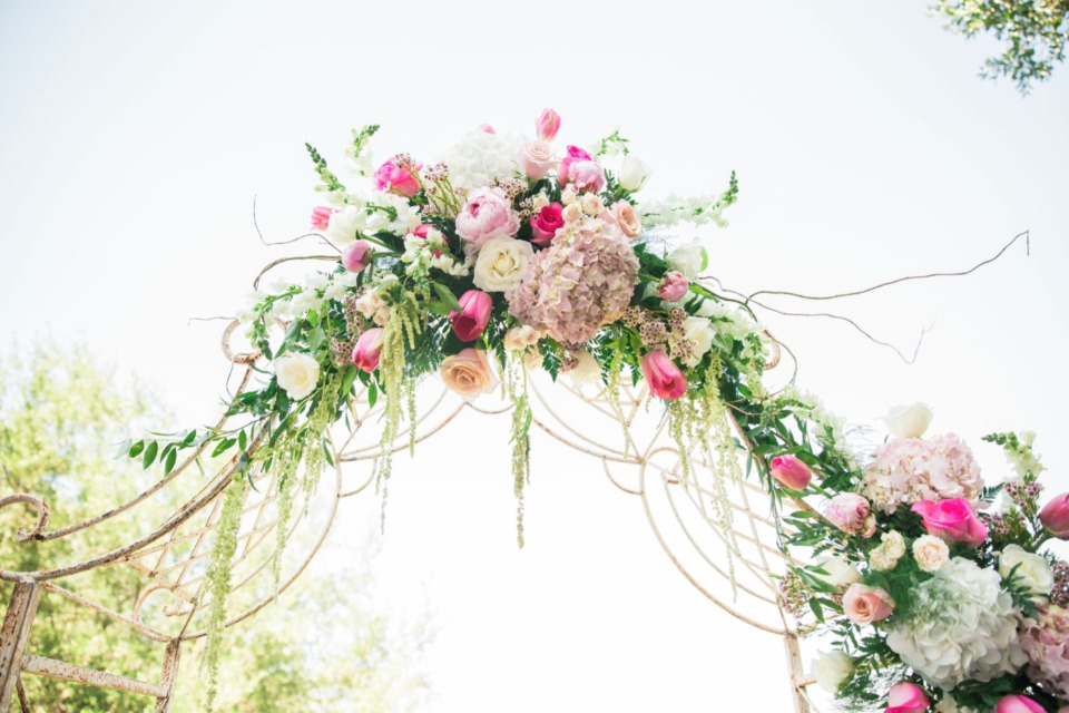 flowering wedding arch with florals by Dee Dee's Boutique & More