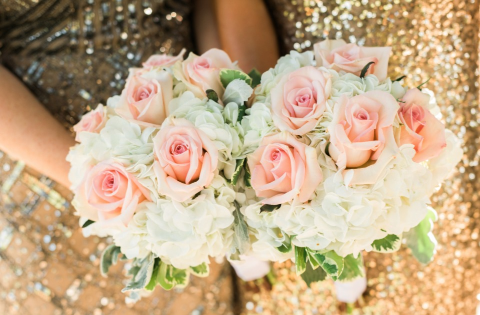 pink rose and white hydrangea bouquets
