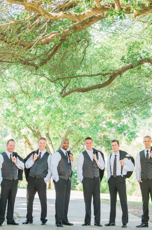 groom and his men in three piece suits