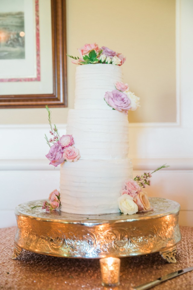 wedding cake accented with fresh flowers