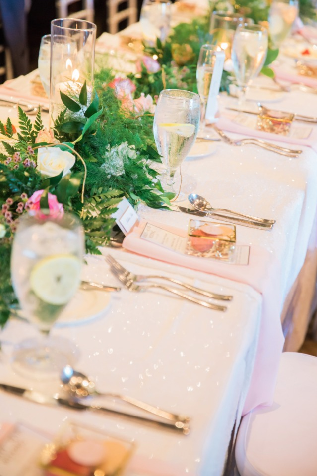 family style seating with floral garland centerpiece