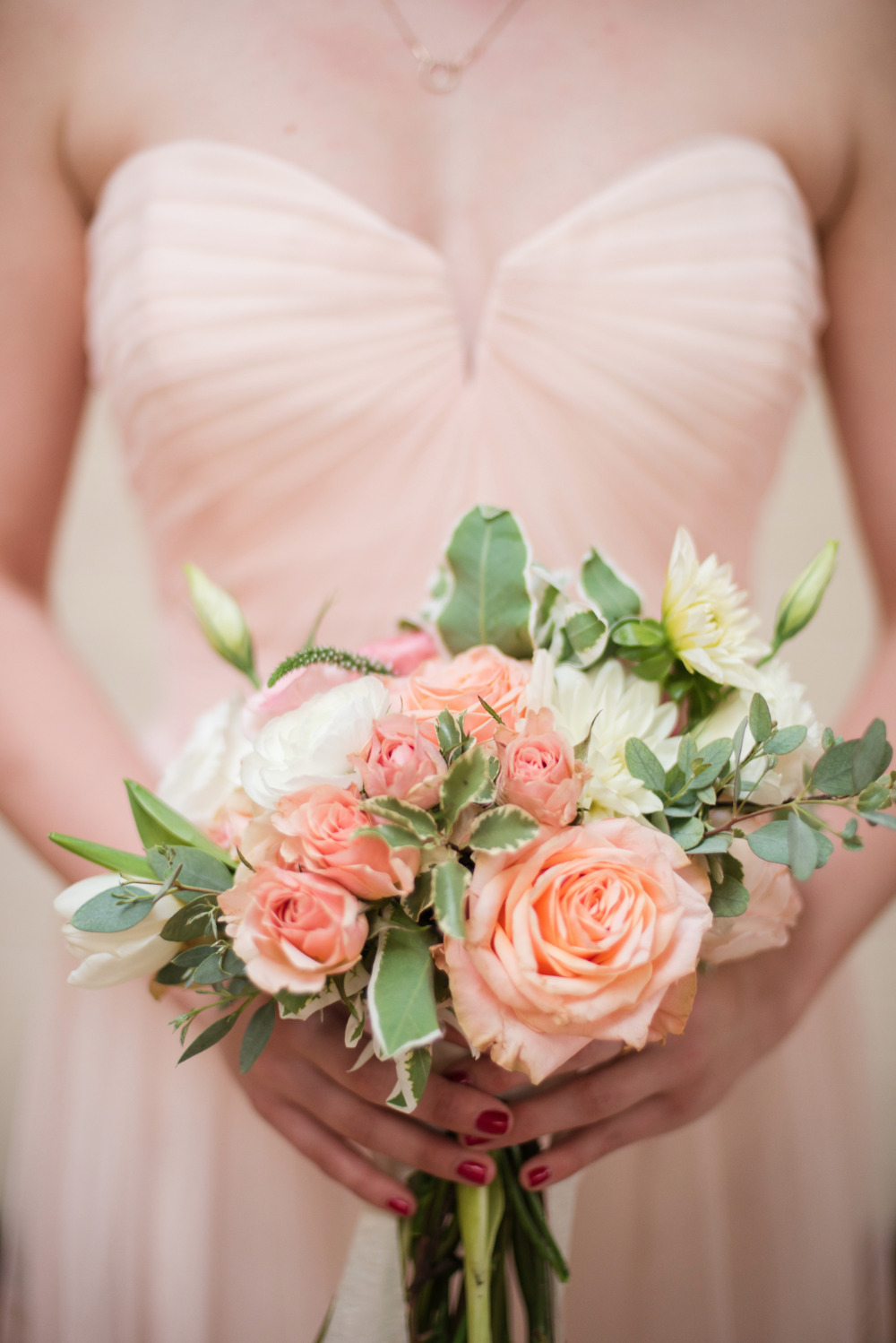 peach and pink rose bridesmaid bouquet