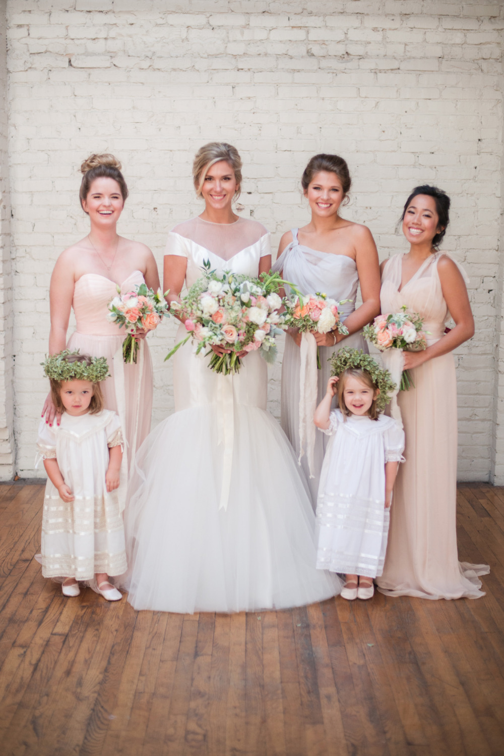 white and peach bridesmaids dress with flower girls