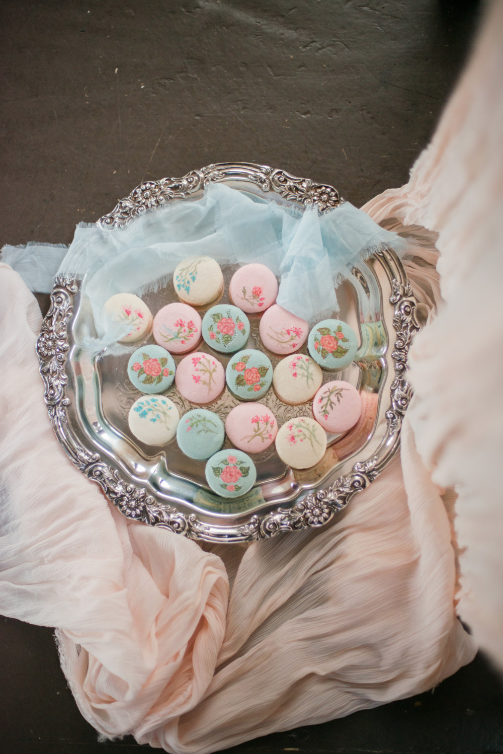white blue and pink floral macarons