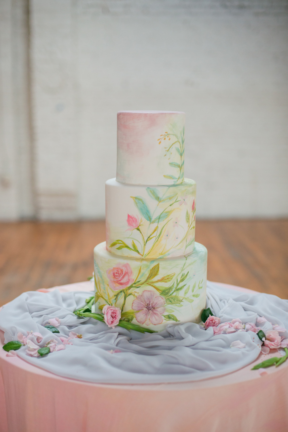 blue and pink watercolor wedding cake