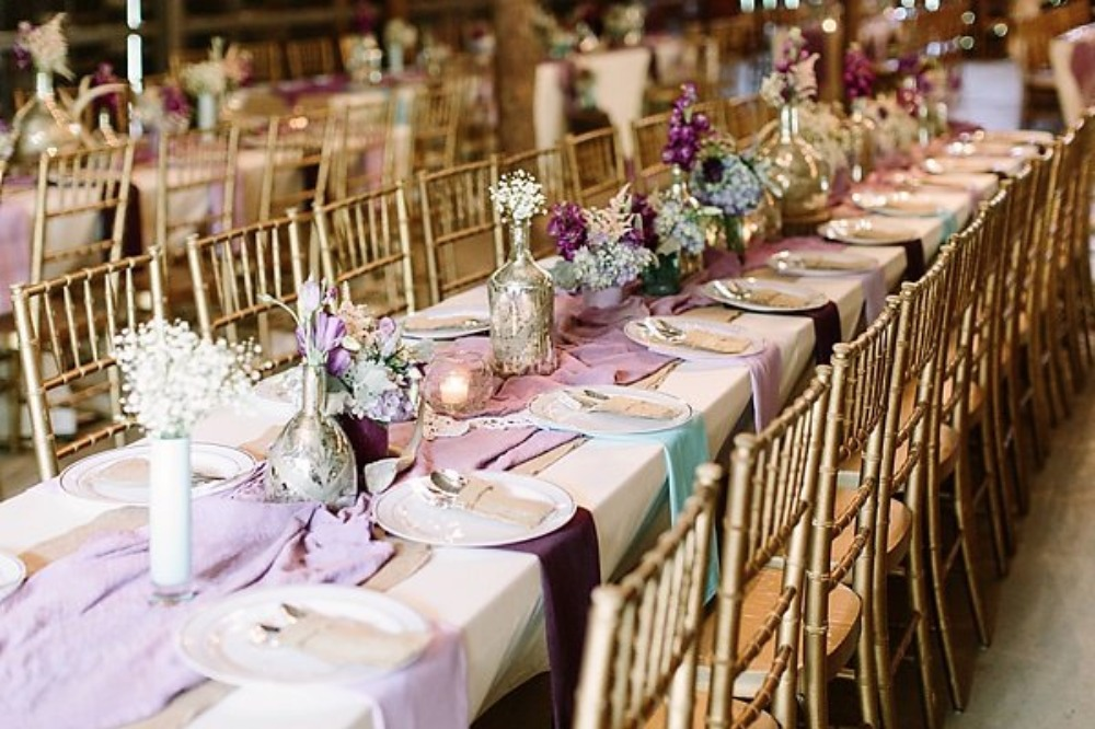 long family style seating with purple and blue decor