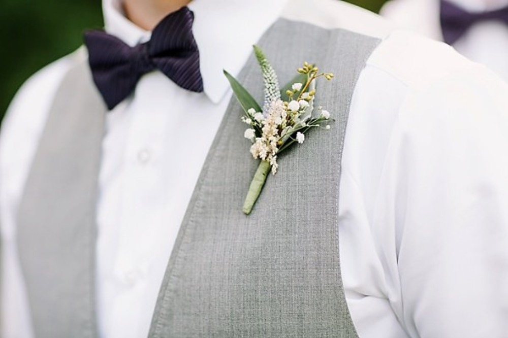 groom boutonniere in white and green