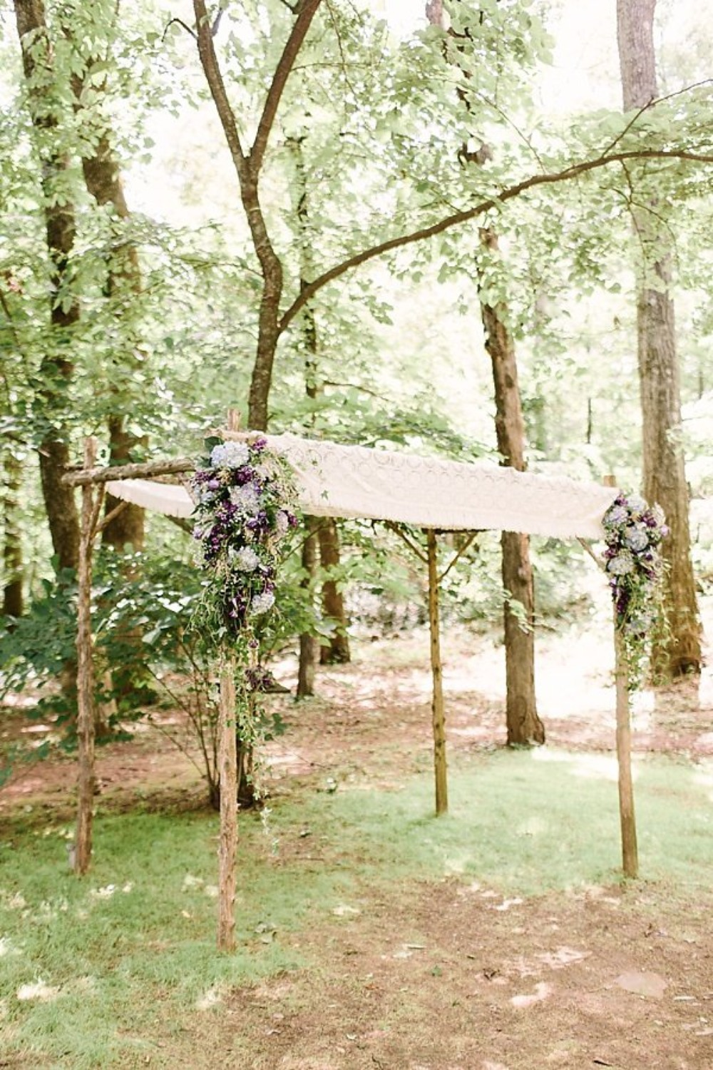 wedding arbor with purple flower accents