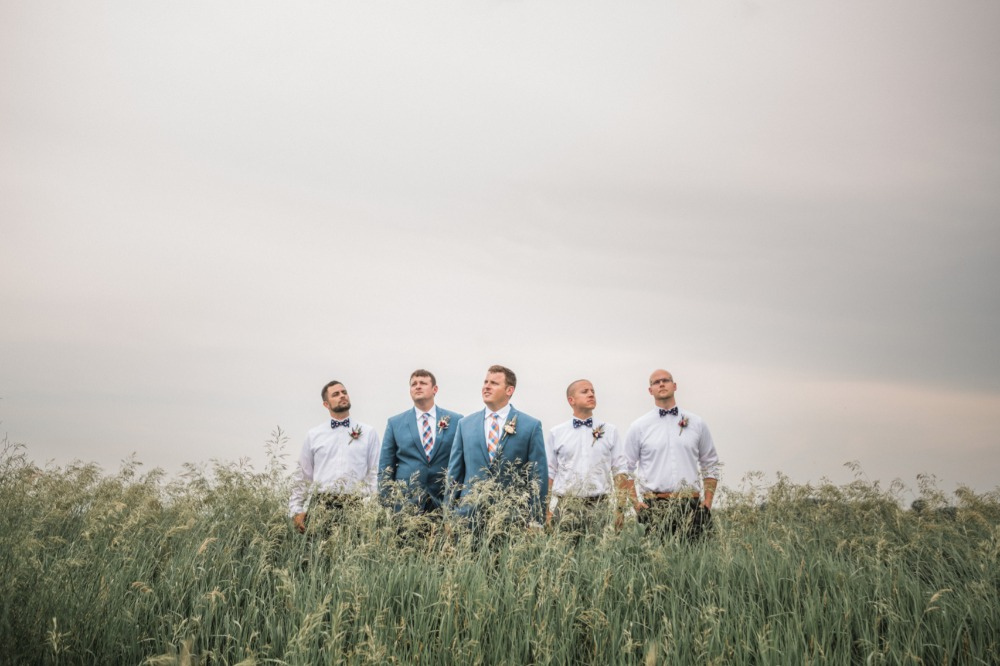 groom and his men out in a field