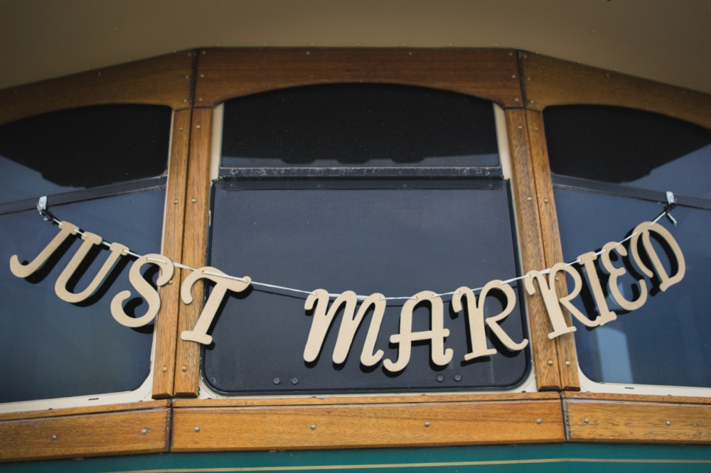 just married wedding sign on the back or the trolly