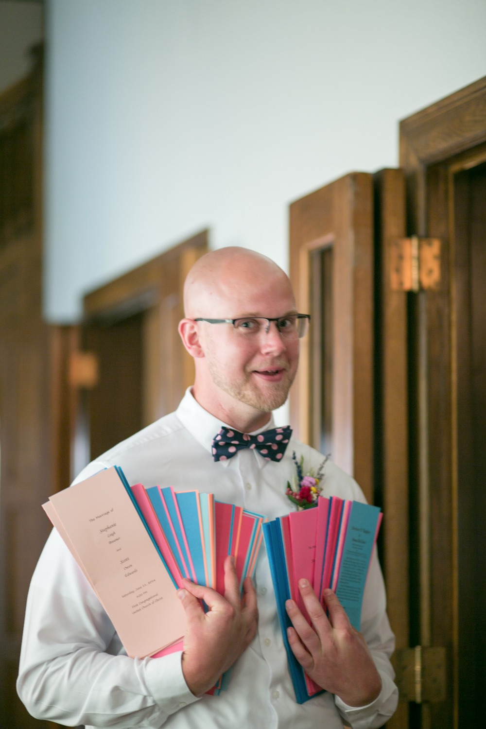handing out wedding programs