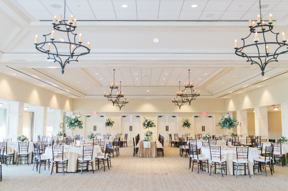 wedding reception with pretty candle chandeliers