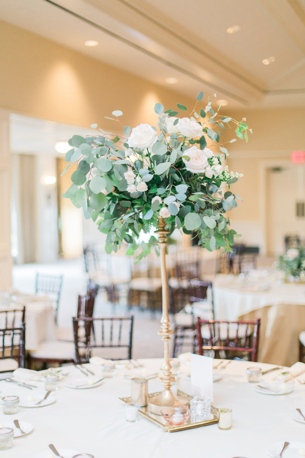 eucalyptus and rose floral wedding centerpiece