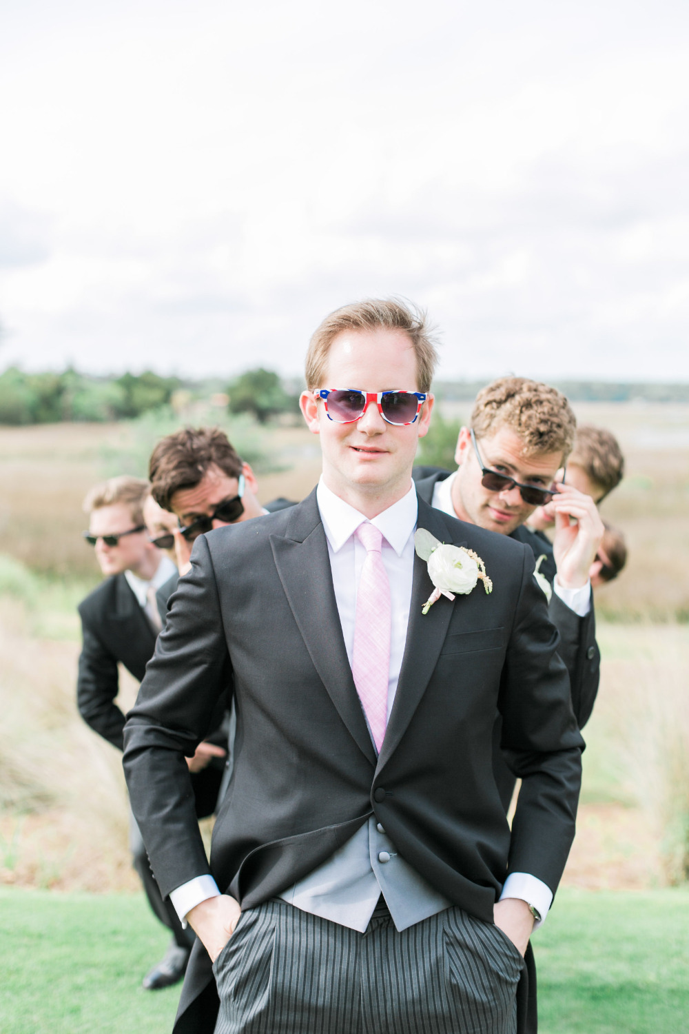 stylish black and pink groomsmen with brit sunglasses