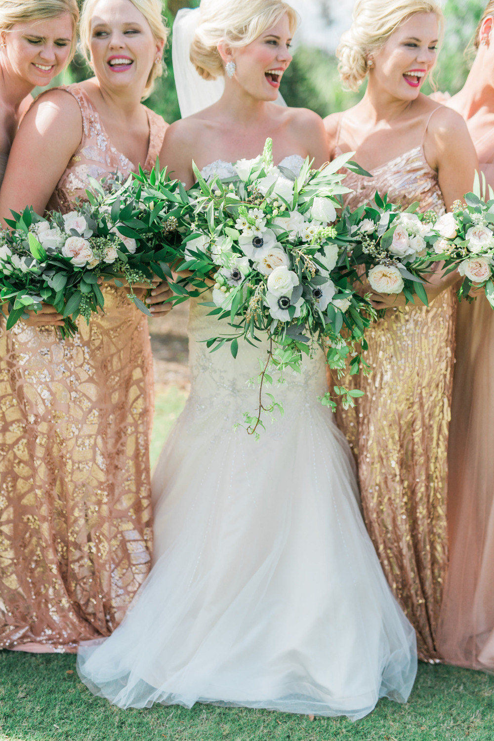 fun bridesmaids photo with pink and gold dresses