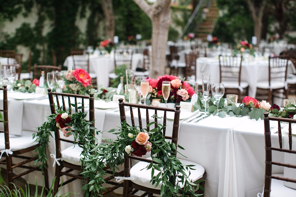 Chair floral decor for bride and groom