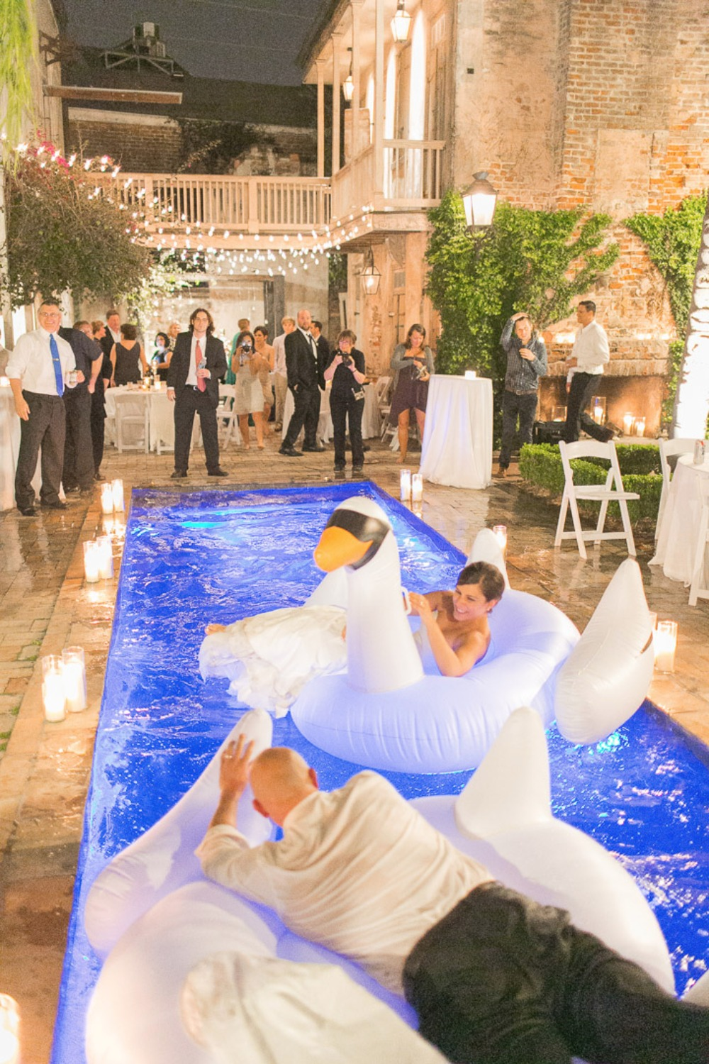 inflatable swan floats for an impromptu pool party