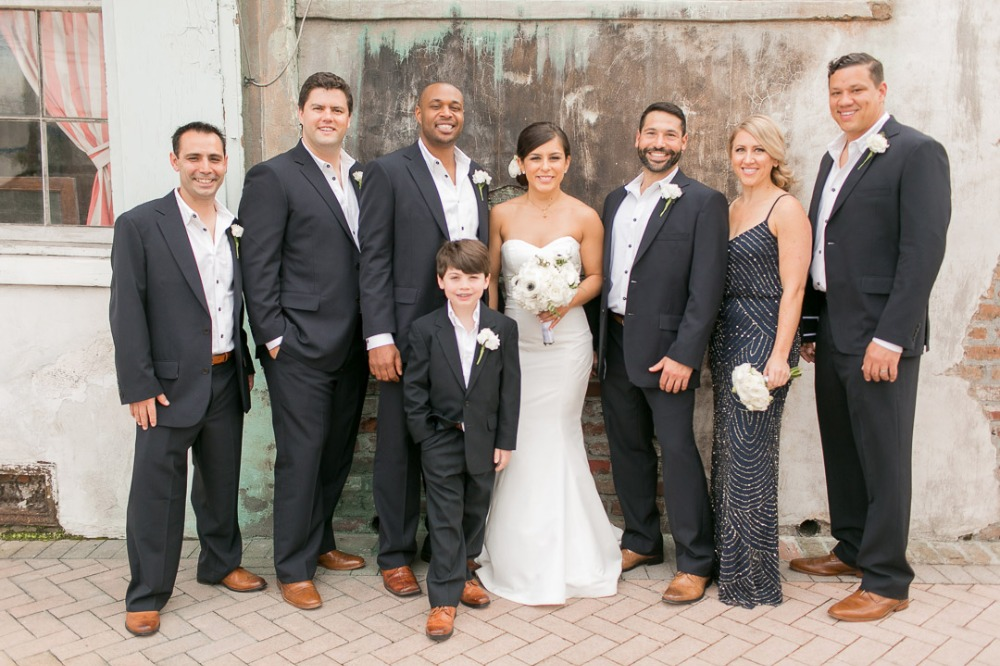 black and white groomsmen and woman