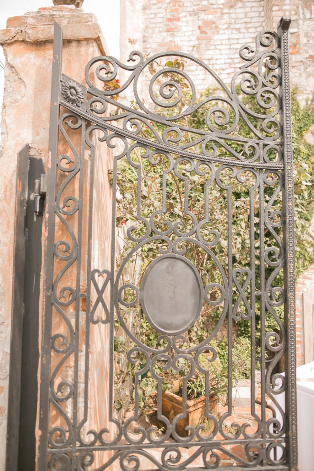 rot iron scrolling fence