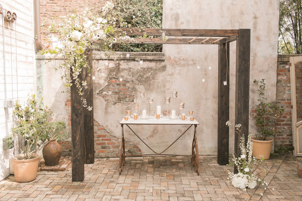 modern industrial wedding arbor accented with cascading flowers