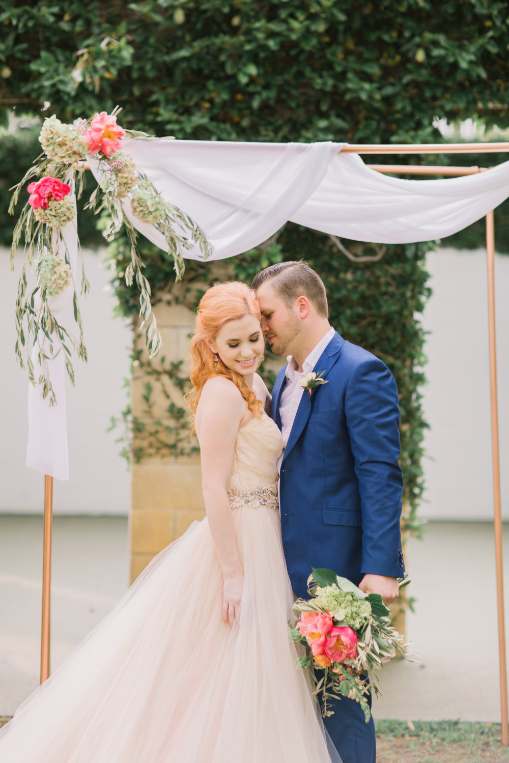 wedding ceremony draped backdrop with flowers