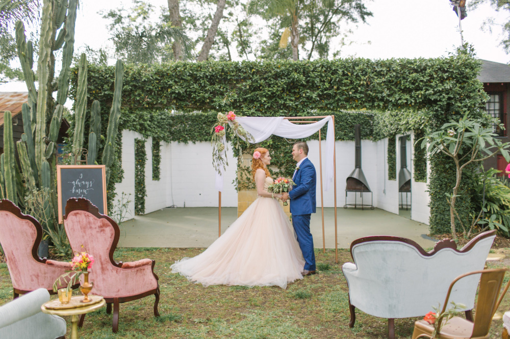 outdoor wedding ceremony with mix and match vintage seating