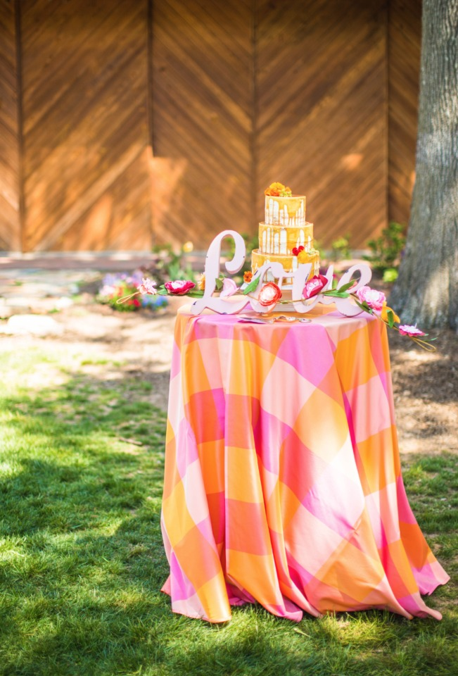 love this wedding cake table and how bright and happy it is