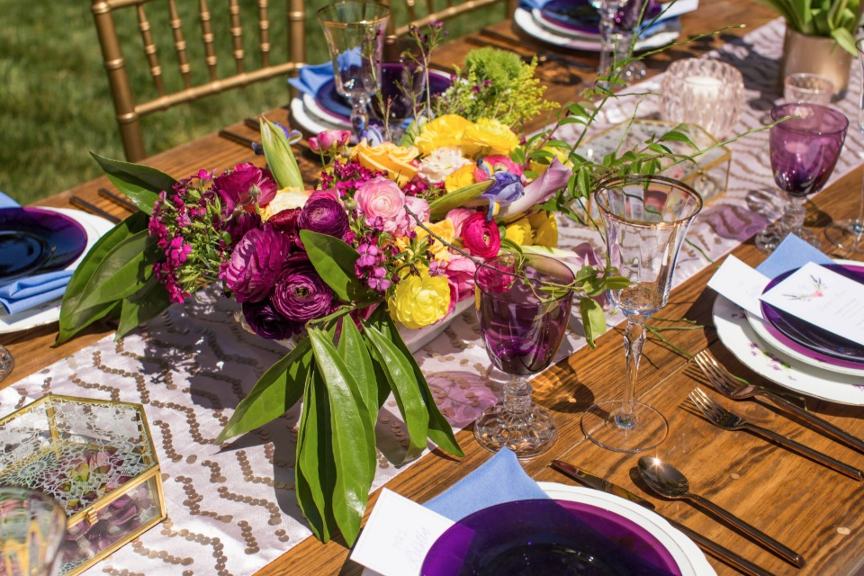 purple yellow pink and gold floral centerpiece and table decor