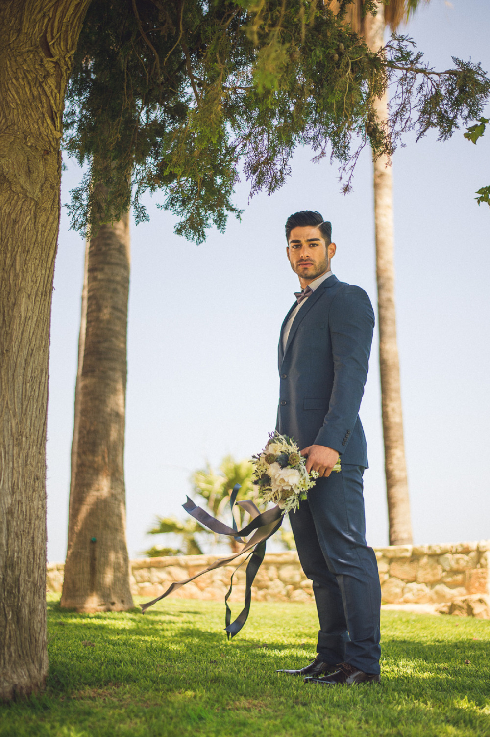 navy blue modern groom look