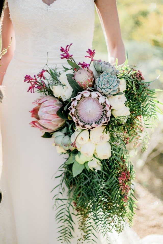 desert themed wedding bouquet with king protea and succulent