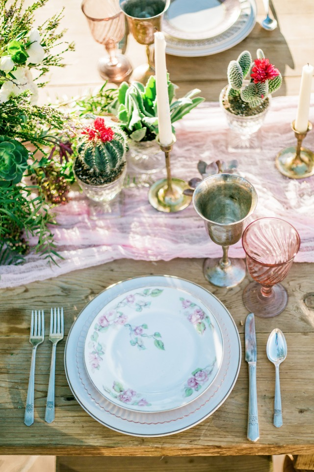 table decor with mini cacti and soft pink details