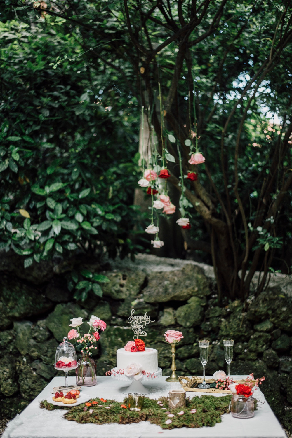 pink and red wedding dessert table
