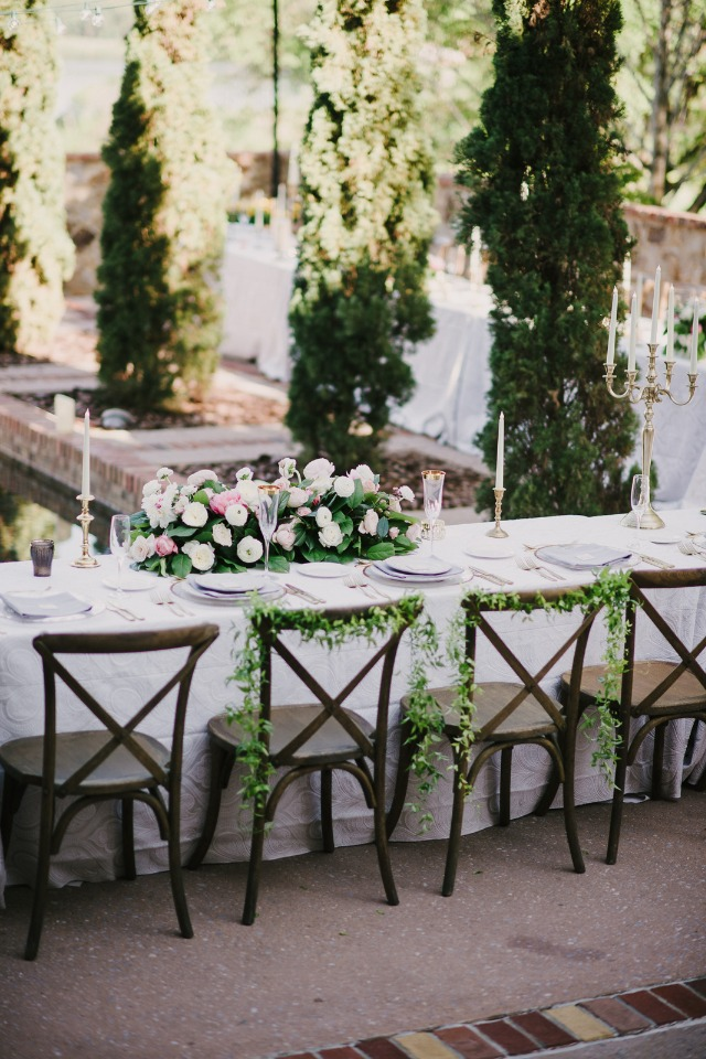 ivy draped bride and groom wedding seats