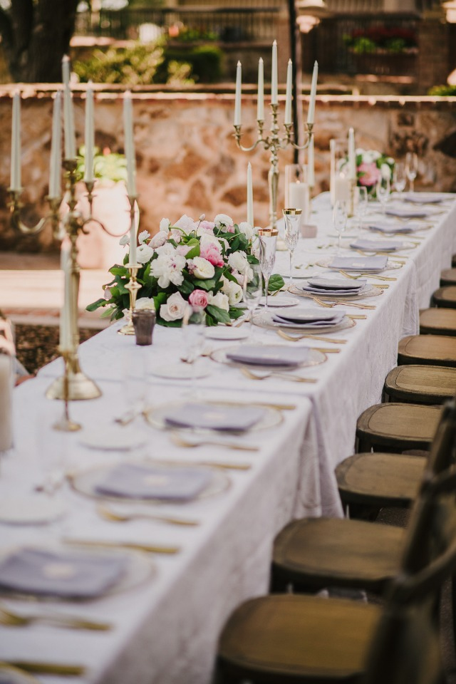 candle lined wedding table in glamorous family style seating
