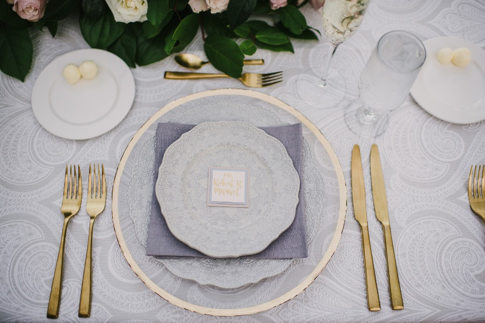 gold and grey table setting