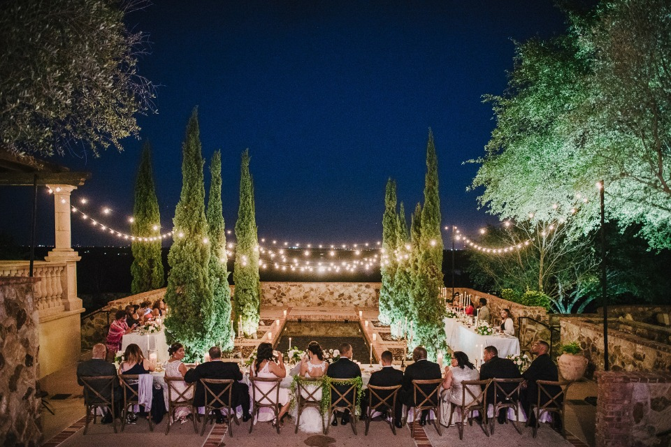 wedding lit up with romantic bistro lights