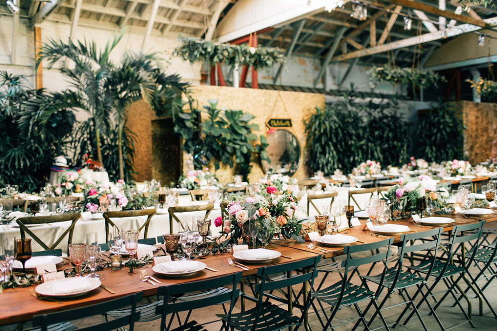 romantic wedding reception with tons of flowers
