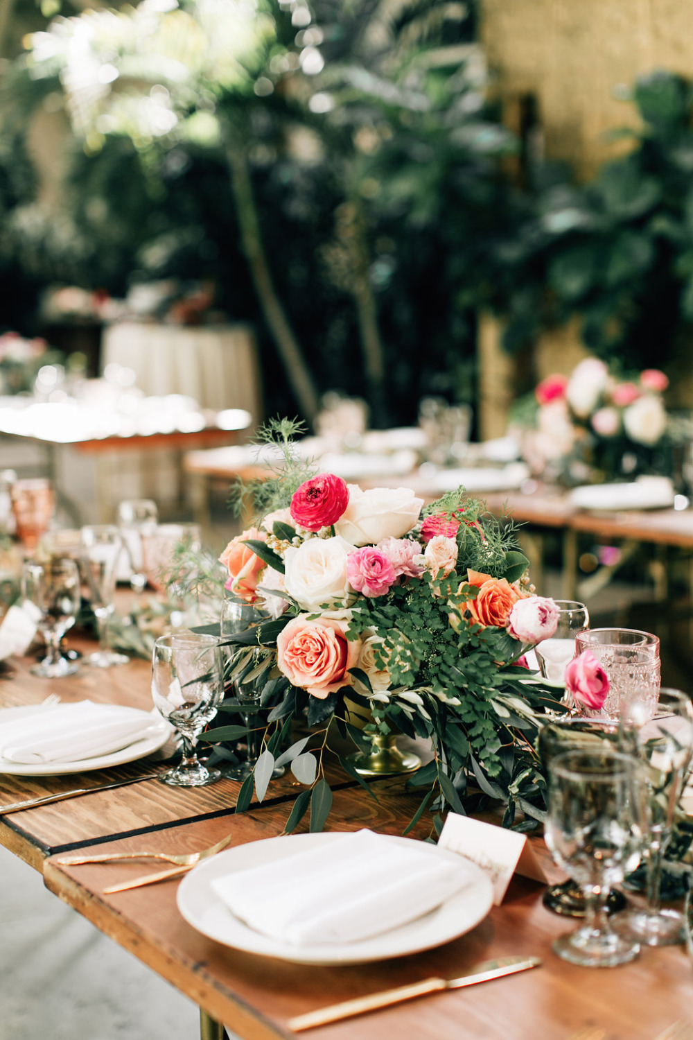 pink and peach ranunculus and rose centerpiece