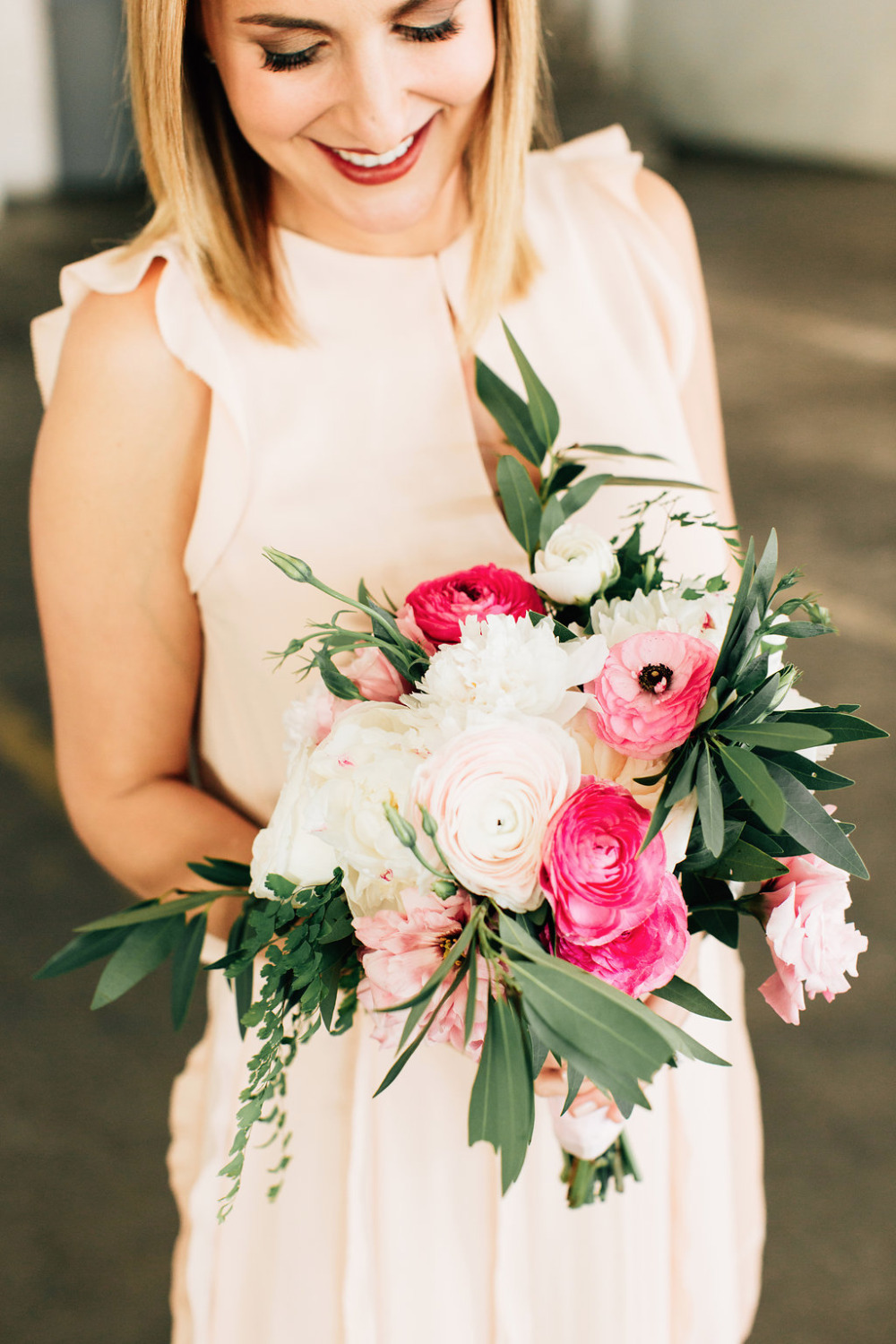pink bridesmaids dresses with bouquet