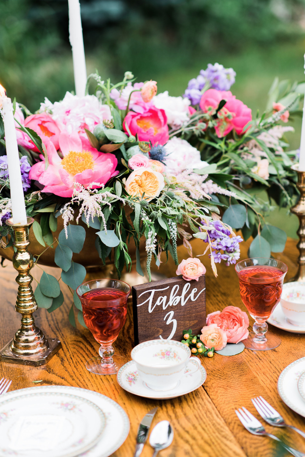 pink and purple floral wedding centerpiece